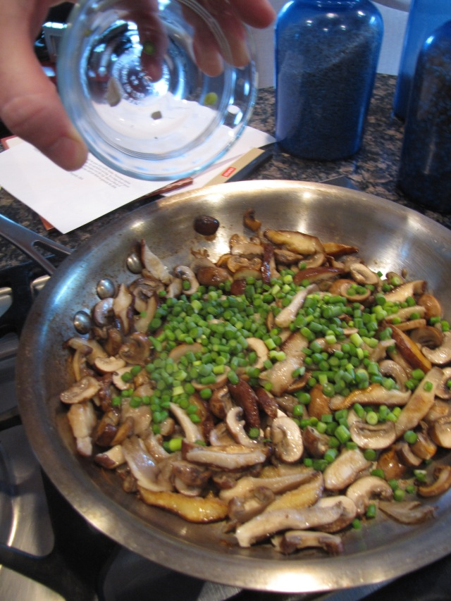 Add chopped garlic scapes to mushrooms.